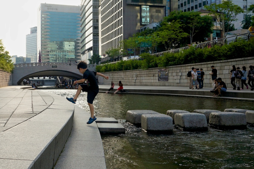 boy crossing cheonggyecheon seoul