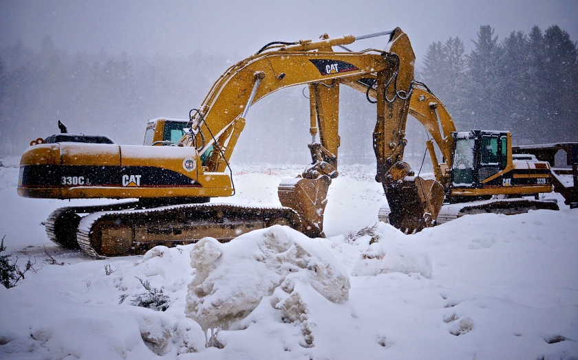 Prettiest excavators since Korea cuddle up in the snow.