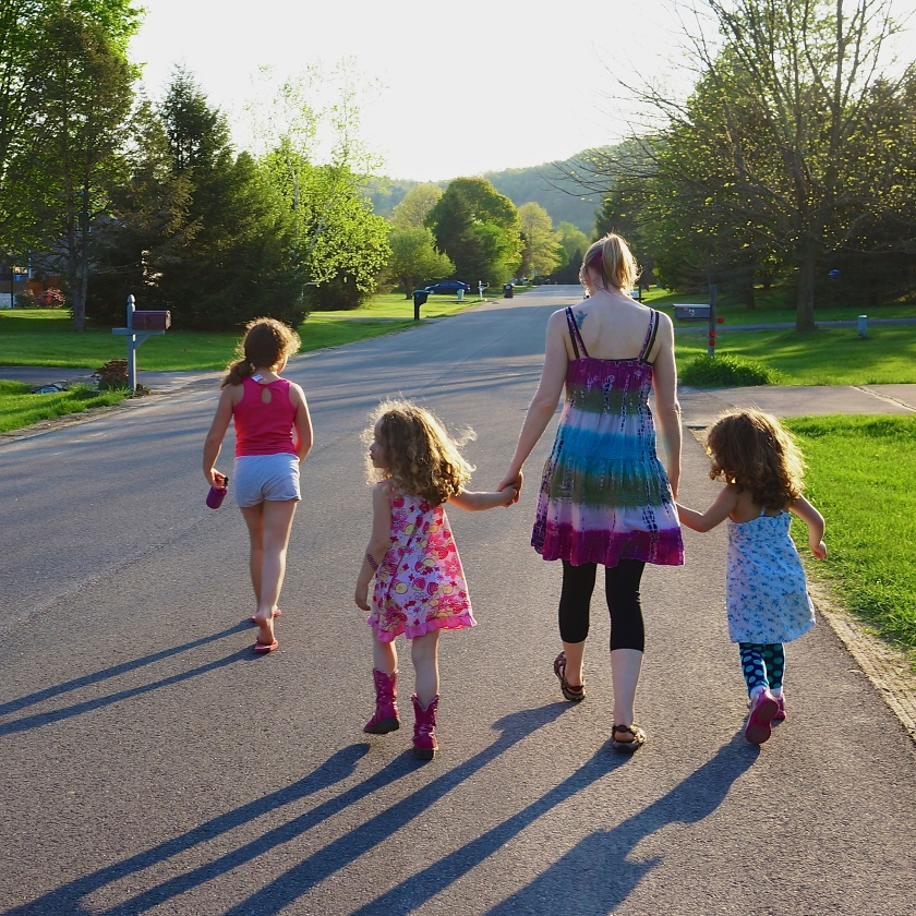 Kate & the kids on a neighbourhood walk.