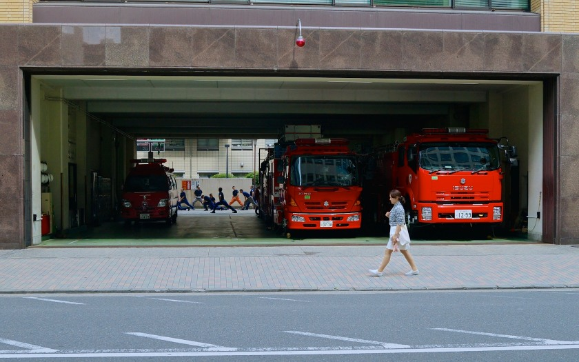 Firemen doing their morning exercise drills, Tokyo.